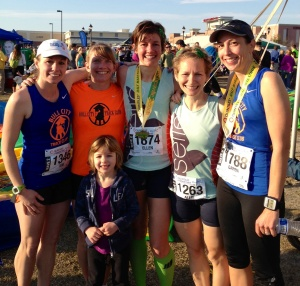 The whole gang sporting our shiny new half marathon PRs!