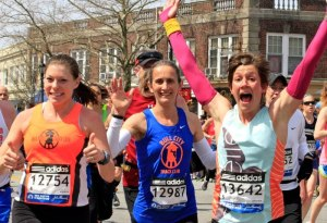 This is how much fun we were having at mile 14. By the way, this pic can also be found on the front page of the Wednesday, 4/17 edition of my hometown's local newspaper.